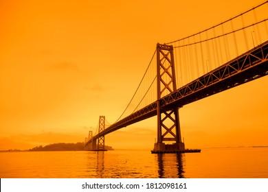San Francisco, California, USA, September 09, 2020, San Francisco Downtown Wildfire air pollution sky orange yellow glow in the bay area vertical bay bridge