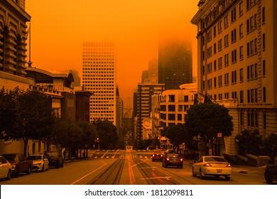 San Francisco, California, USA, September 09, 2020, San Francisco Downtown Wildfire air pollution sky orange yellow glow in the bay area vertical