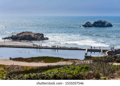 San Francisco, California/USA-8/15/18: The shoreline near the Sutro Bath ruins showing the Cypress trees, green hillsides and seal rocks off Lands End