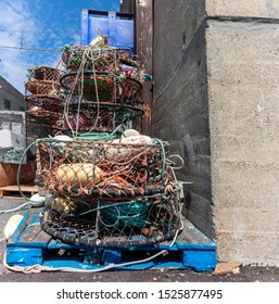 San Francisco, California/USA-8/9/19: Fishermans  Wharf fishing dock showing empty crab nets, traps and bins for the fishing industry, preparing for the catch.