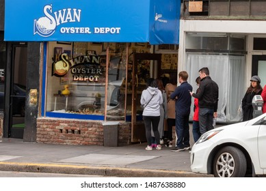 San Francisco, California/USA-January 25, 2019: A line of customers waiting for a seat to eat at Swan Oyster Depot, a family run fresh fish eatery landmark which opened in 1903 on Polk Street
