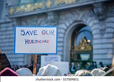 SAN FRANCISCO, CA/UNITED STATES â?? JANUARY 15 2017: A person holds a sign to save Obamacare at city hall in downtown San Francisco.during a Healthcare Rally.