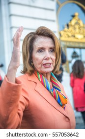 SAN FRANCISCO CA/UNITED STATES - JANUARY 15 2017: Nancy Pelosi, congresswoman of 12th congressional district of San Francisco talks to constituents after a Healthcare Rally in front of city hall.