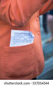 SAN FRANCISCO CA/UNITED STATES - JANUARY 15 2017: Pocket of Nancy Pelosi, congresswoman of 12th congressional district of San Francisco with messaging. during Healthcare rally at city hall.