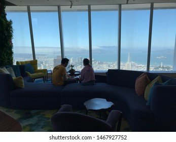 San Francisco, CA/USA - July 31 2019: Visitors and tourists watching aerial view of the city skyline from the observation deck. Golden Gate Bridge and the Transamerica pyramid in the background.