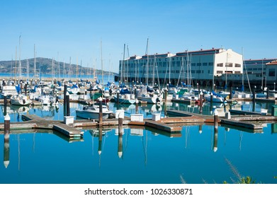 SAN FRANCISCO, CA/USA - FEBRUARY 03, 2018: View of moored sailboats and marina docks with the Fort Mason Golden Gate National Recreation Area in the background