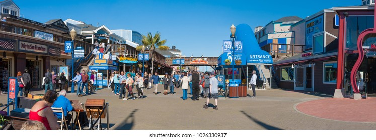 SAN FRANCISCO, CA/USA - FEBRUARY 03, 2018: Panorama of Tourists visiting San Francisco's  Pier 39 near Fisherman's Wharf