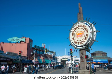 SAN FRANCISCO, CA/USA - FEBRUARY 03, 2018: Tourists visit San Francisco's Fisherman's Wharf District with  several famous restaurants in the background
