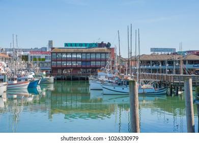 SAN FRANCISCO, CA/USA - FEBRUARY 03, 2018: Fishing boats at the docks in San Francisco bay at Fisherman's Wharf in San Francisco, CA