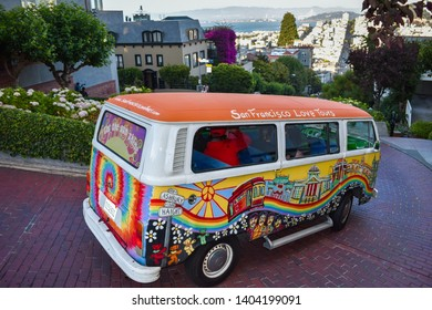 SAN FRANCISCO, CA/USA, July 8, 2017 - Colorful Love Tours van driving along Lombard street. Tourist activity in Bay city.