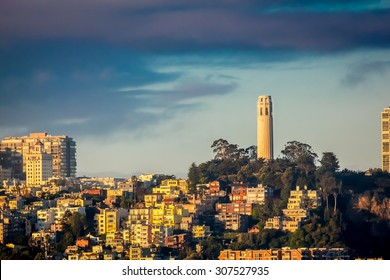 The San Francisco city skyline and Coit Tower at sunrise.