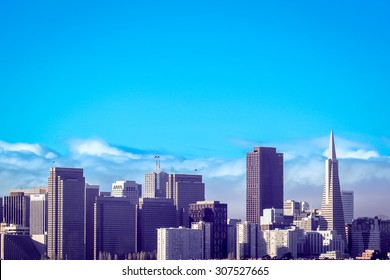 The San Francisco city skyline at sunrise.