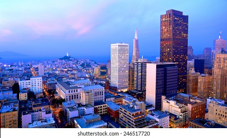 San Francisco cityscape with a view of famous skyscrapers and landmarks with colorful clouds at dusk
