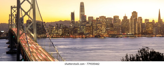 San Francisco Downtown and Bay Bridge in the golden hours. Yerba Buena Island, California, USA.