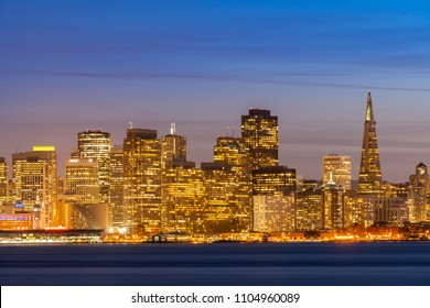 San Francisco downtown skyline at dusk from Treasure Island, California, sunset, USA.