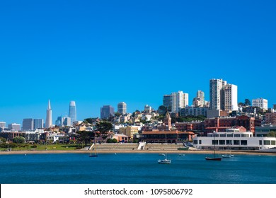 San Francisco with famous landmarks including coit tower, saleforce building and ghirardelli,  day time with bluw sky