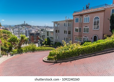 San Francisco, the famous Lombard Street, winding street in Russian Hill, with the Coit tower in background