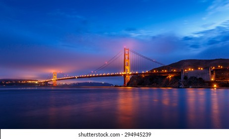 San Francisco Golden Gate Bridge illuminated at night in California, USA