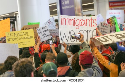 San Francisco International Airport, California - January 29, 2017: Thousands of protesters gather at SFO to protest President Trump's travel ban on Muslims.