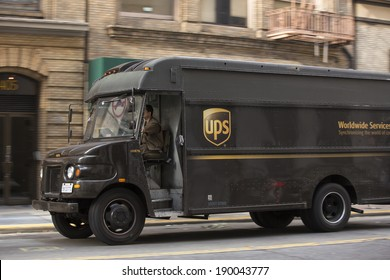 SAN FRANCISCO - JANUARY 1: UPS driver delivers packages on January 1, 2014 in San Francisco. UPS is one of largest package delivery companies worldwide.