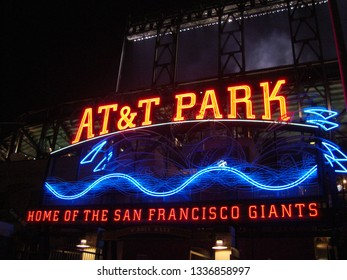 San Francisco - January 30, 2010: AT&T Park - Home of the Giants - Neon Sign at night with visual of baseball splashing into the water at Att Park in San Francisco California.