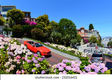 SAN FRANCISCO - JULY 13: Cars travel down Lombard Street on July 13, 2013 in San Francisco, CA. Lombard Street is famous for its eight consecutive hairpin turns.