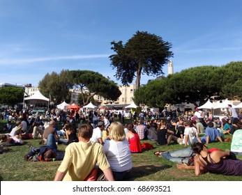 SAN FRANCISCO - JUNE 14:  People sitting around watching the North Beach Festival Concert on stage Washington Park taken June 14, 2009 San Francisco, CA