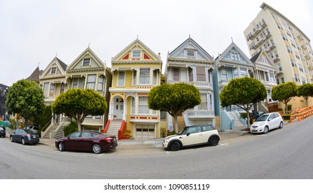 """SAN FRANCISCO - JUNE 16: The famous row of colorful Victorian houses known as the """"Painted Ladies"""" on June 16, 2013 in San Francisco, CA."""