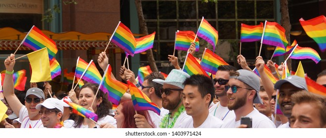 SAN FRANCISCO - JUNE 28 : Gay Pride Parade participants marching and waving rainbow flags, June 28, 2015