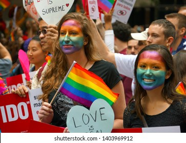 SAN FRANCISCO - JUNE 28 : Two young women with painted faces watch the Gay Pride Parade, June 28, 2015