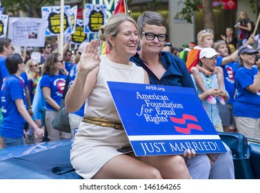 SAN FRANCISCO -  JUNE 30 : Kris Perry and Sandy Stier from the American Foundation for Equal Rights take part at the annual San Francisco Gay pride parade on June 30 2013