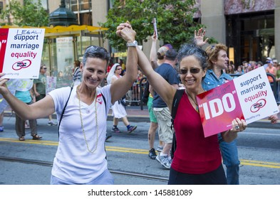 SAN FRANCISCO -  JUNE 30 : An unidentified Lesbian couple participates at the annual San Francisco Gay pride parade on June 30 2013