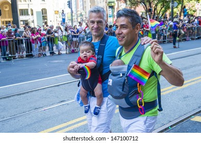 SAN FRANCISCO -  JUNE 30 : An unidentified Gay couple participates at the annual San Francisco Gay pride parade on June 30 2013