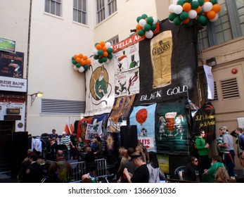 San Francisco -  March 13, 2010:  Band plays on stage at St. Patrick's Day Block Party in street as people watch and drink.