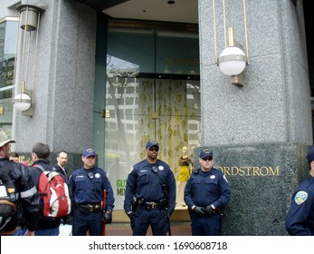 San Francisco -  March 19, 2008: SFPD police officers guard entrance to Nordstrom during protest in city.