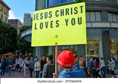 SAN FRANCISCO - MAY 17 2015:Christian man holds a Jesus Christ Love You sign during a protest.As of 2010, Christianity was by far the world's largest religion, with an estimated 2.2 billion adherents.