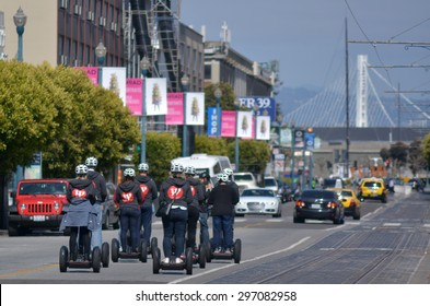 SAN FRANCISCO - MAY 17 2015:Segway PT tours in San Francisco.In 2002 the city banned the Segway PT from safety concerns, However, Segway Tour operations use them in cycle lanes and designated trails.