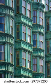 SAN FRANCISCO - MAY 19 2015:The windows of Columbus Tower Sentinel Building in San Francisco CA.The distinctive copper-green Flatiron style structure is a San Francisco designated landmark.