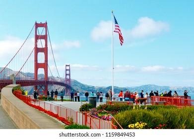 SAN FRANCISCO - MAY 19 2015:Visitors at the Golden Gate Bridge in San Francisco California.More than 10 million people visit the Golden Gate Bridge each year about 27,000 visitors per day.