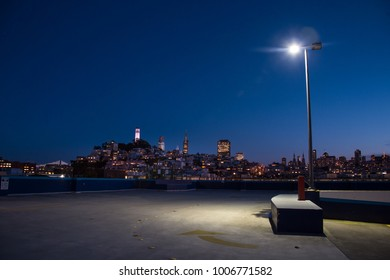 San Francisco Night Skyline seen from Parking Lot with Street Light at Night.