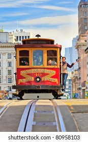 SAN FRANCISCO - NOVEMBER 26:Unidentified passengers enjoy a ride in a cable car on Nov. 26, 2010 in San Francisco, California. It is the oldest mechanical public transport in San Francisco which is in service since 1873.