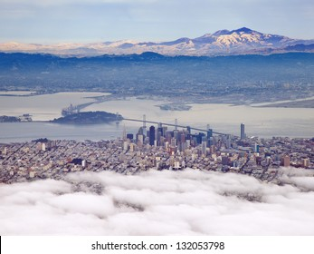 San Francisco shrouded in fog with Mt Diablo in the distance