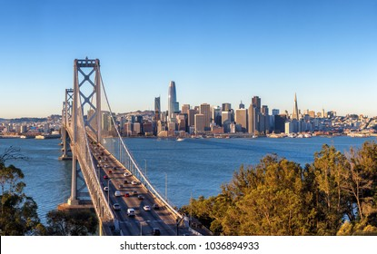 San Francisco skyline and Bay Bridge at sunrise, California