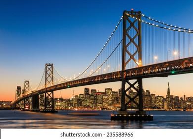 San Francisco skyline and Bay Bridge at sunset, California USA