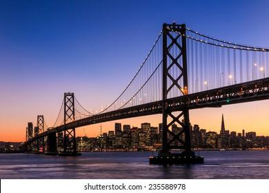 San Francisco skyline and Bay Bridge at sunset, California USA - Shutterstock ID 235588978