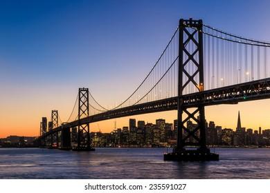 San Francisco skyline and Bay Bridge at sunset, California USA - Shutterstock ID 235591027