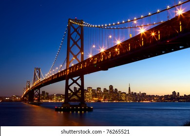 San Francisco skyline and Bay Bridge at sunset, California, USA