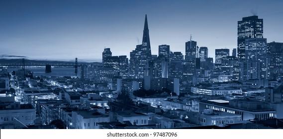 San Francisco skyline with Bay Bridge at twilight.