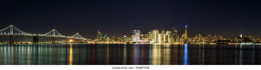 San Francisco skyline at night with city and Bay Bridge lights