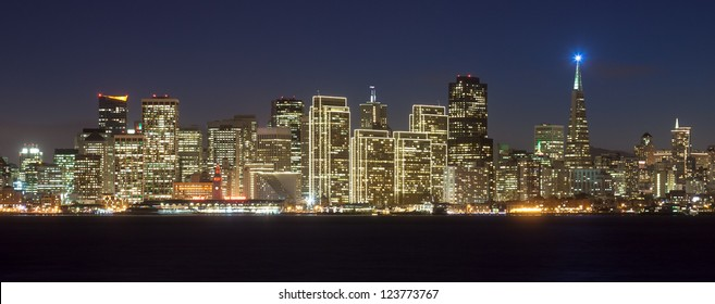 San Francisco skyline at night, with holiday season lights.